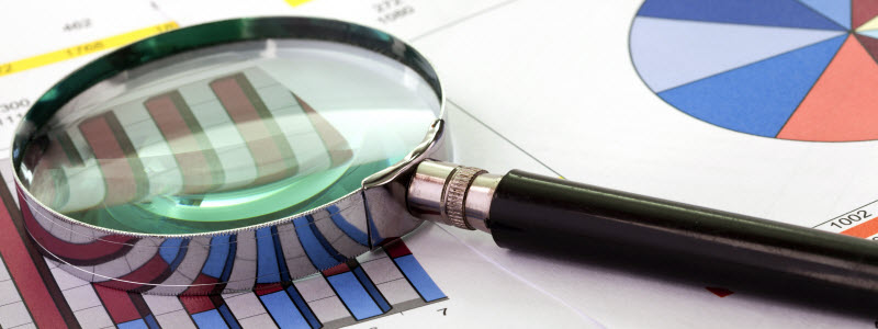 Magnifying glass over data and analytics