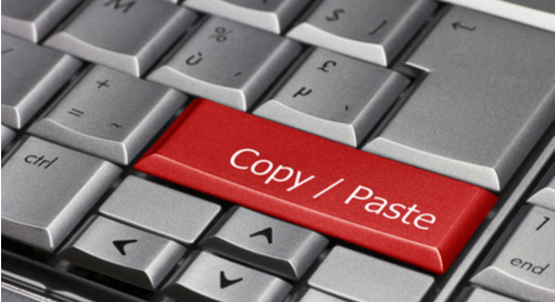 "Picture of red key on computer keyboard that says ""Copy / Paste"""