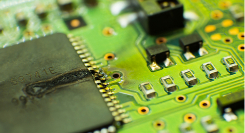 Burnt CPU on a PCB.