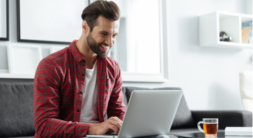 Picture of man happy using a computer