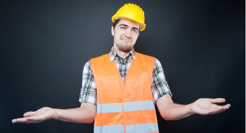 Constructor wearing equipment making confused or wondering gesture with hands