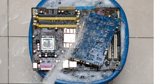 Cleaning a computer motherboard in a bucket of water