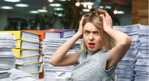 Woman overwhelmed by too much documentation