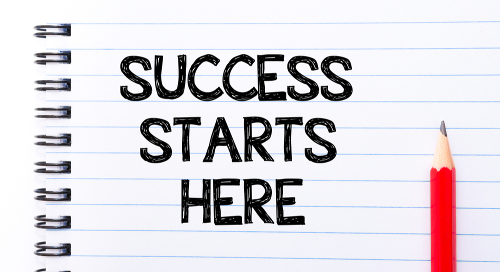 "Notepad with ""Success Starts Here"" written on it"
