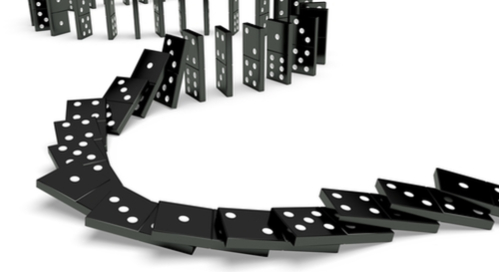 Picture of a string of dominoes falling