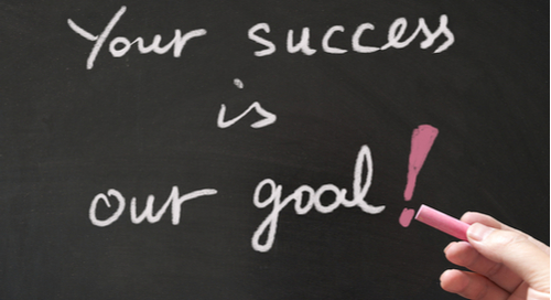 Your success is our goal written in chalk on a blackboard
