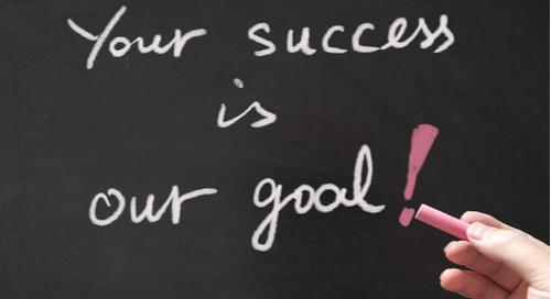 Your success is our goal written in chalk on a blackboard