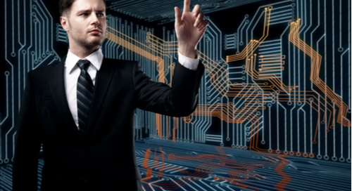 Businessman pointing to PCB circuitry