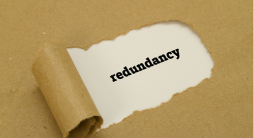"""Redundancy"" written under torn paper"