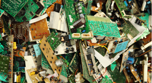 A pile of PCBs in the trash.