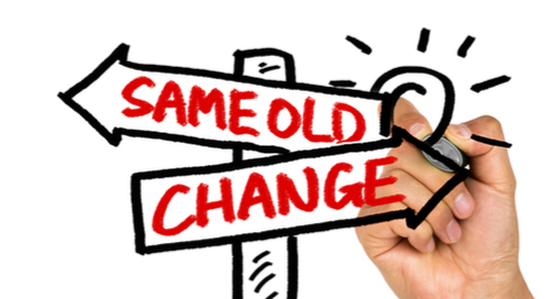 """Hand drawing signpost that says """"same old"""" and """"change"""""""