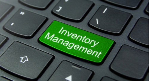 Green inventory management button on keyboard