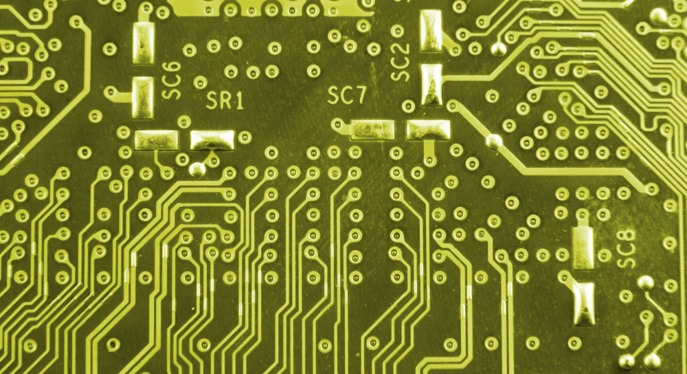 Yellow image of circuit board trace routing