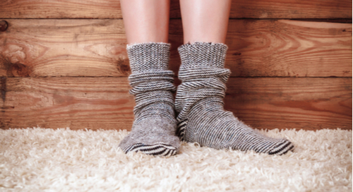 person wearing socks on a carpet