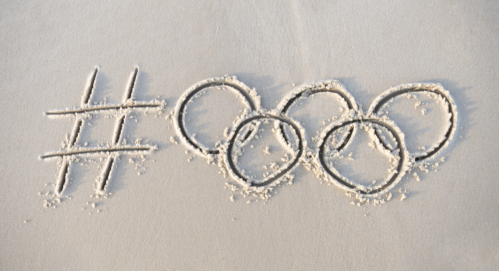 Olympic symbols written in the sand