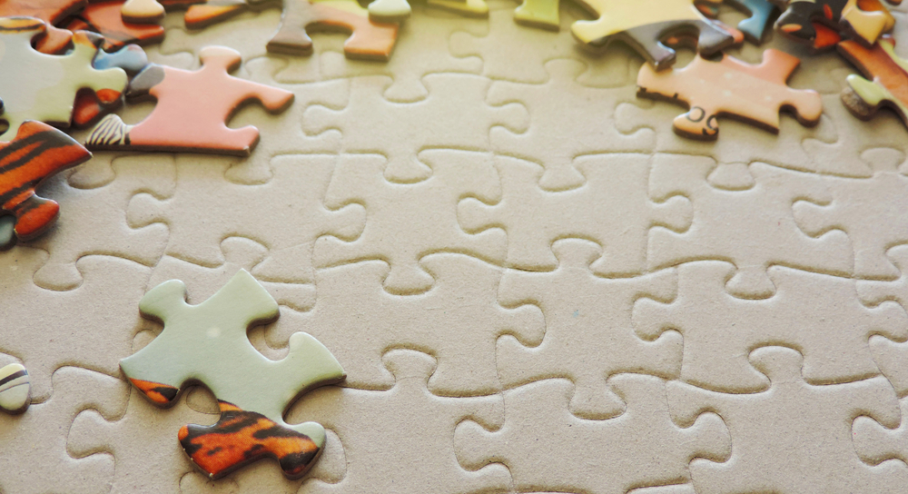 Jigsaw pieces on a puzzle background.