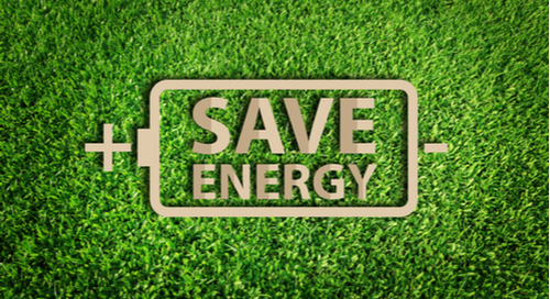 Energy saving concept. Paper cut of eco on green grass