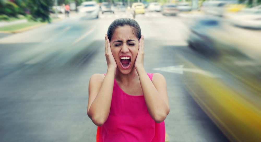 Woman screaming in the middle of a street