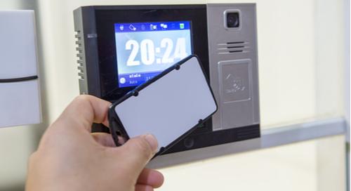 Hand using keycard to open digital lock