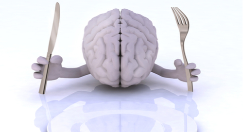 Brain holding fork and spoon