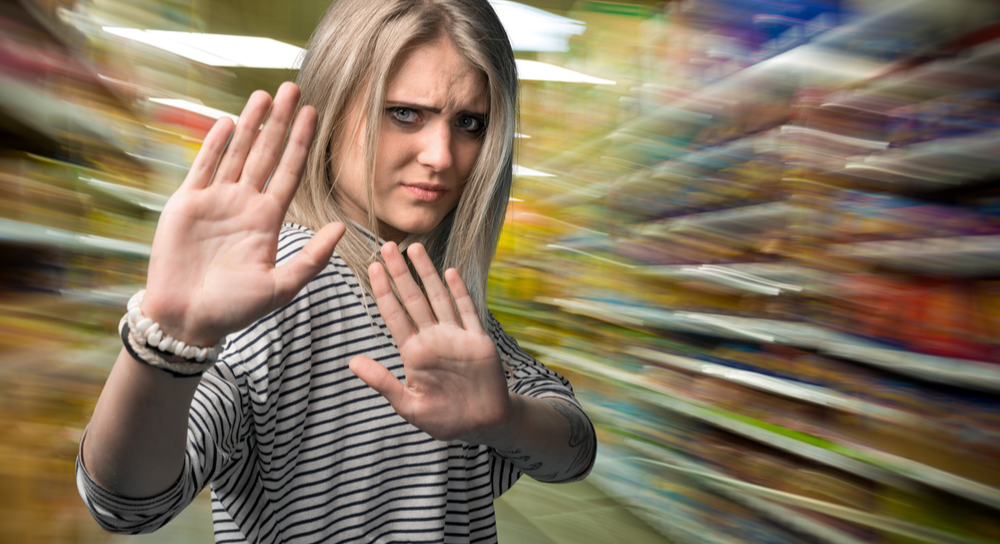 woman gesturing to stop at a shopping mall