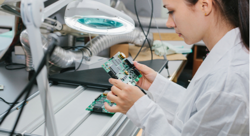 Picture of woman assembling PCB