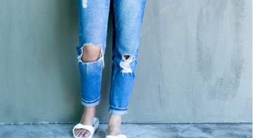 Jeans with holes in the knees.