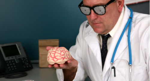 Doctor wearing x-ray googles to look at a brain.