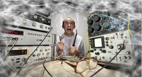 Nerdy scientist soldering