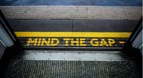 Photograph between doorway and outside with yellow words 'mind the gap'
