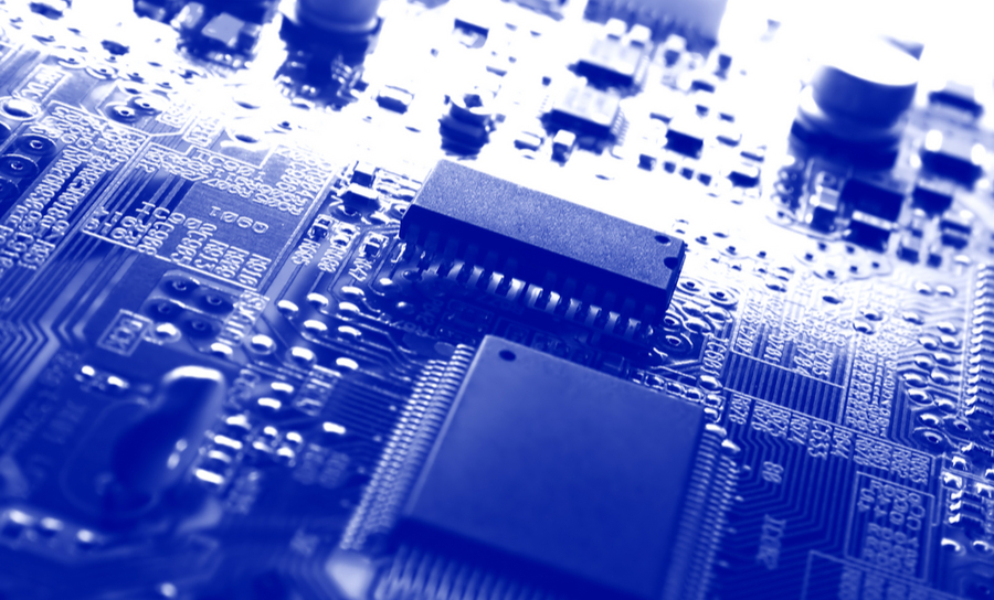 Blue electronics board showing components on a circuit board