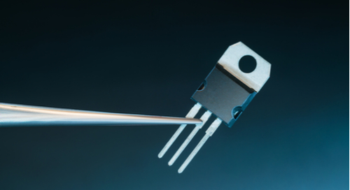 Power transistor on blue background with metal jutting out