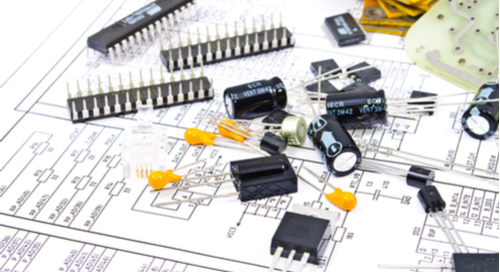 PCB components against a schematic background