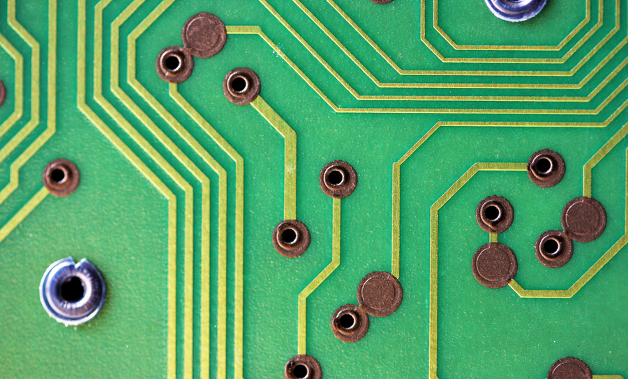 Close-up of circuit board with vias