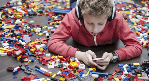 Kid surrounded by Legos