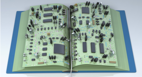 Picture of PCB components on a library book