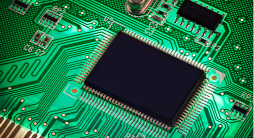 Microcontroller on green circuit board
