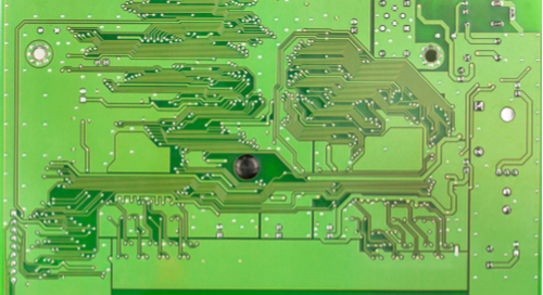 Green circuit board with mounting holes displayed