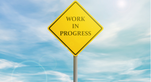 "Yellow sign saying ""Work In Progress"""