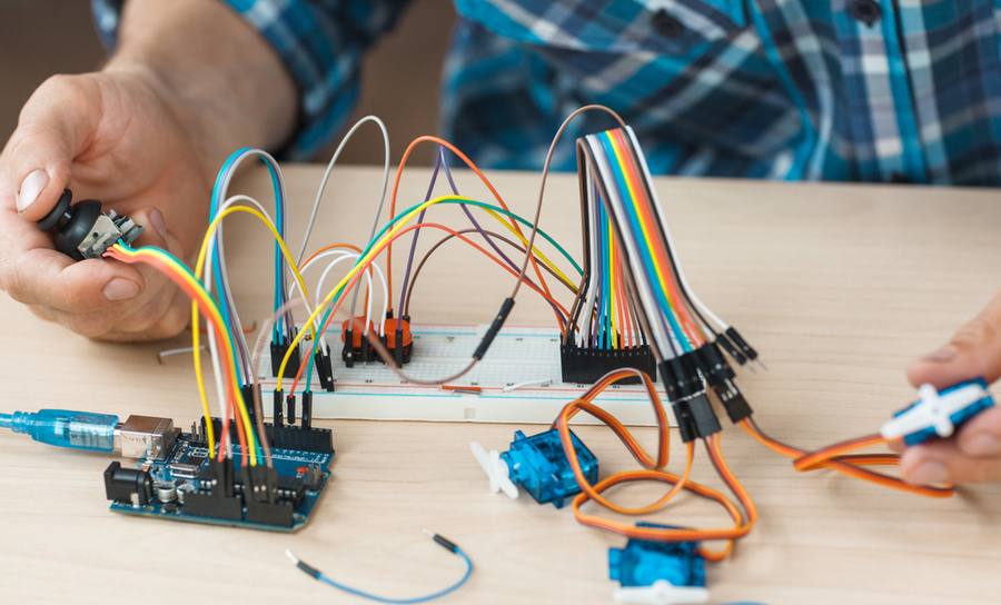 Person with LED routing for a microcontroller