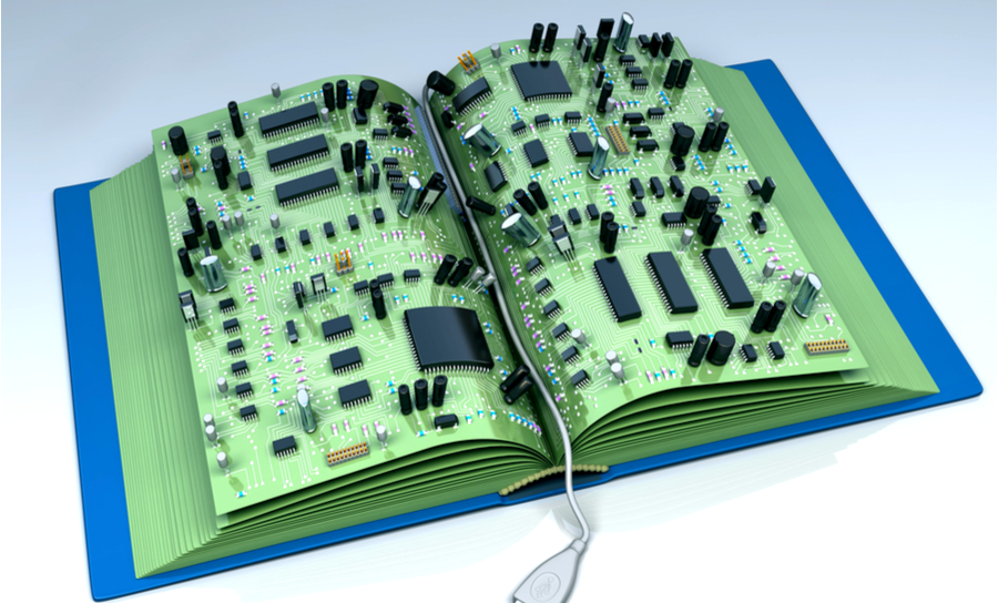 Image of electronic components on a book