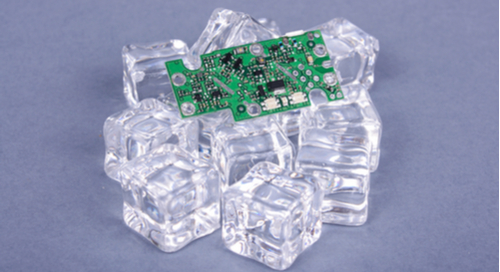 PCB on a stack of ice cubes to cool it down