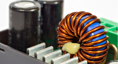 Inductance coil and capacitors of power supply unit