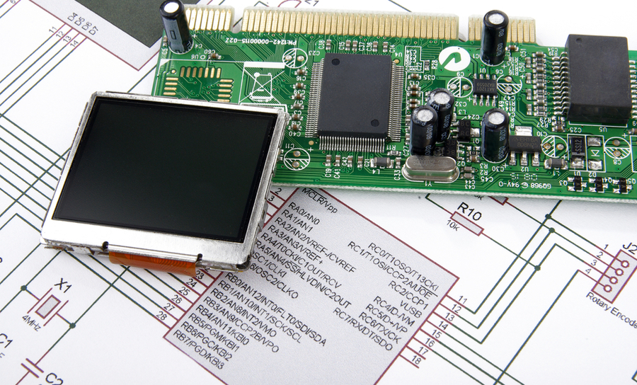 Picture of PCB and display on top of a schematic