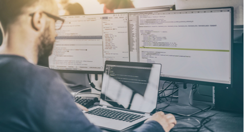 Web developer in front of code on computer