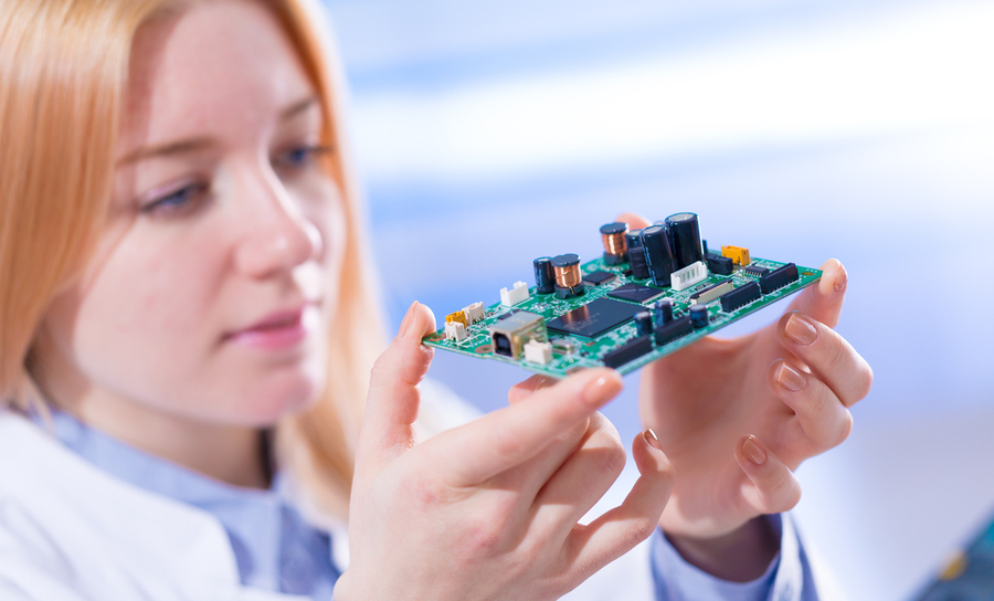 Picture of woman holding PCB in supply chain solutions