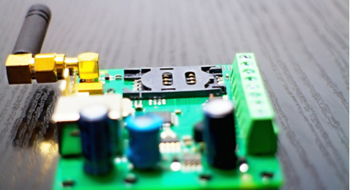 SIM card holder and antenna on a green PCB