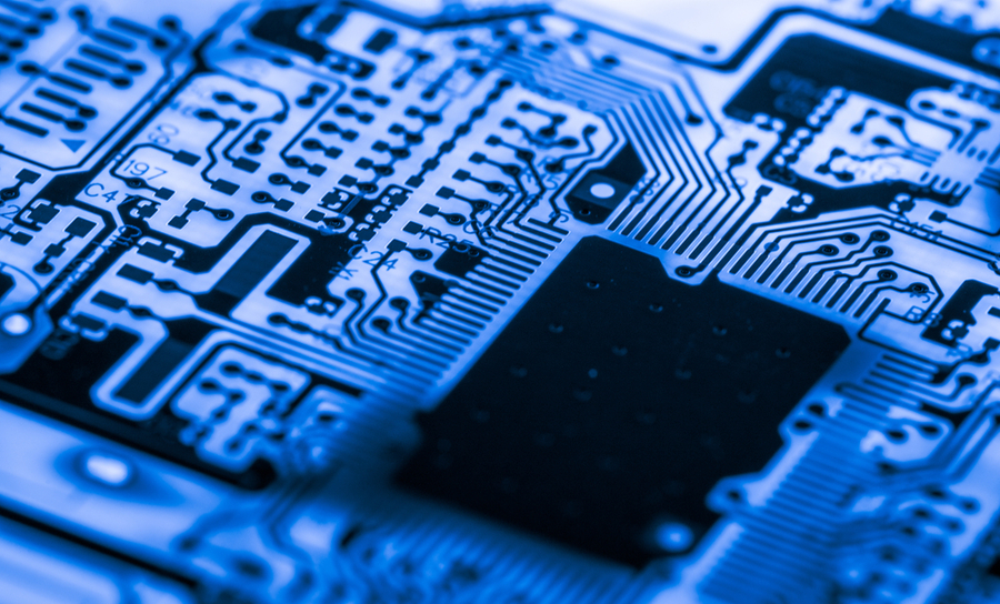 Close-up electronic device on a blue PCB