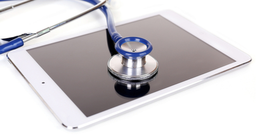 Blue stethoscope on a tablet