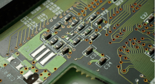 SMD components and vias on a green PCB